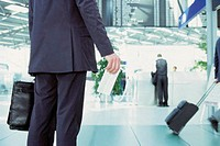 Businessman holding airline ticket