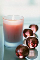 Candle with bath pearls
