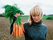 Farmer proudly showing her carrots