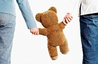 Couple holding teddy bear