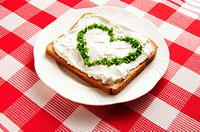 Chives in heart shape on sandwich