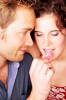 Couple eating heart shaped sweets