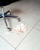Blood covered surgical gloves on floor
