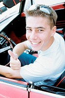 Young man in sports car