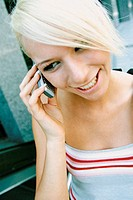 Young woman on cellphone (thumbnail)