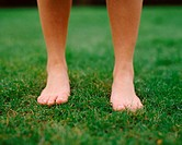 Woman on grass with bare feet