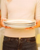 Woman holding white plates