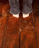 Woman's bare feet on wooden floor