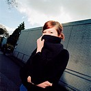 Girl covering her face with wool scarf