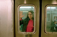 Female commuter on subway train