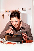 Young woman with fuse-box