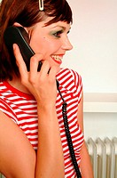 Smiling young woman on phone
