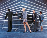 Blind Businessmen and Businesswomen Walking in a Line Holding Walking Sticks