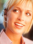 Portrait of a Young, Smiling Businesswoman Wearing a Headset and Looking Sideways