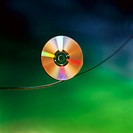 Cd-Rom disk on tightrope