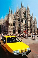Yellow cab in front of Duomo (cathedral). Milan. Italy