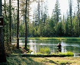 Woman fly-fishing. Fall River. Deschutes National Forest. Bend. Oregon. USA