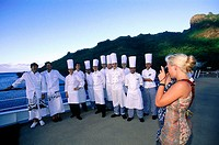Chefs and cooks posing for picture at deck of MS Paul Gauguin. French Polynesia