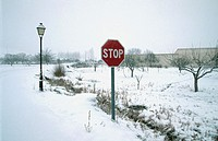 Snow covered traffic sign. Tragacete, Serranía de Cuenca. Cuenca province, Spain