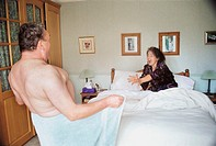 Mature couple relaxing in the bedroom (thumbnail)