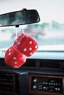 Fluffy dice hanging from a rear view mirror (thumbnail)