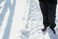 Person standing on snowy path, lower section (thumbnail)