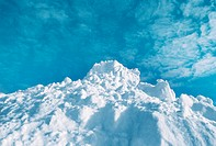 Mound of snow against blue sky (thumbnail)