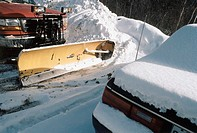 Vehicle with snow plough attached and parked car (thumbnail)