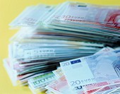 Closeup of neat piles of Euro banknotes of differing values (thumbnail)