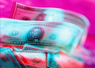 American dollar notes against pink background (thumbnail)