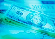 Light green image of American dollar notes laid out (thumbnail)