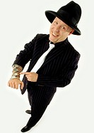 Man dressed in gangster suit grinning naughtily and holding out arm full of watches (thumbnail)