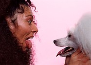 Woman and Poodle Sticking Out Their Tongues (thumbnail)
