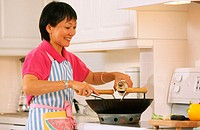 Chinese woman cooking Chinese food