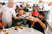 Volunteer serving meals. Annual Thanksgiving lunch for poor. Camillus House. Miami. Florida. USA