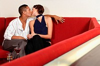 Couple kissing on sofa