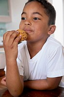 Boy eating a cookie (thumbnail)