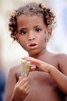 Portrait of a young girl with ice cream. Cartagena, Colombia
