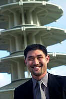Portrait of young man in front of structure in Japan Town, SF