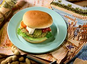 Fish and banana burger on plate, décor: picture, maps