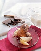 Mousse au chocolat with wedges of pear