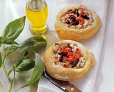 Small tomato pizzas with ricotta on white cloth