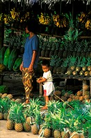 Child  & mother at fruit stands Davao, Philippines