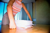 Woman with stack of papers