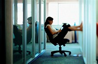 Woman puts feet up at work