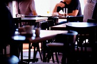 Two men being served in cafe
