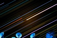 Satellites and star trails in the night sky