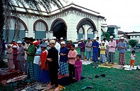 Praying outside Masjid Tanah Merah, Kelantan, Malaysia