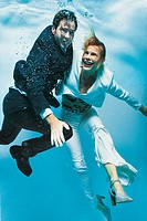 Businessman and a Businesswoman Underwater