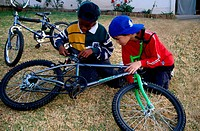 Young boys fixing a bicycle, South Africa